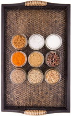Sugar and spices in a wicker tray