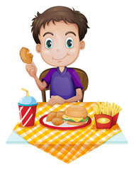 A young boy eating in a fastfood restaurant