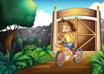 A child biking at the yard