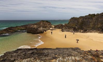 People at Mullimbura point beach near Bingi. Nsw. Australia.