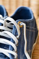 Blue denim casual canvas shoe with laces,