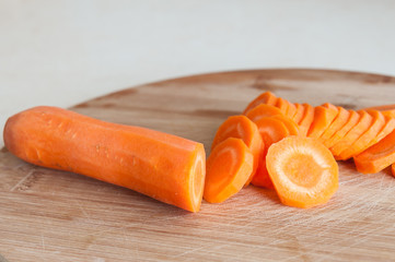 sliced carrots on a wooden board