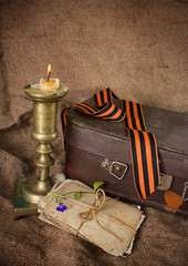 Георгиевская лента, старые фотографии и свеча