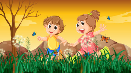 A girl and a boy playing with the butterflies