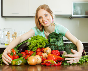 happy woman with heap of vegetables