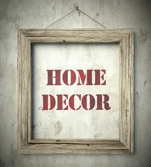 Home decor emblem in old wooden frame
