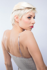 Young blonde woman with creative haircut