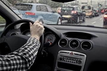 Fototapete - Rainy day in car