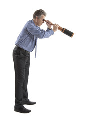 Business man looks a telescope