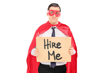 Sad superhero with a sign looking for job