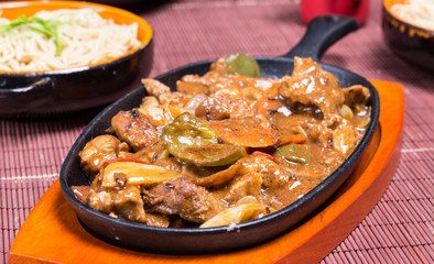 Pork in black bean souse with green pepper and onion