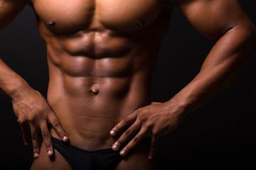 muscular african man 6 packs