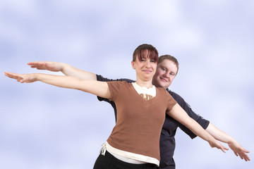 Man and woman stretching her arms out with joy