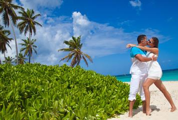 Loving couple on tropical beach