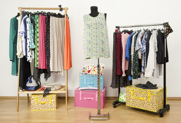 Closet with polka dots clothes arranged on hangers and mannequin