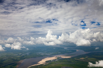 White clouds above great river