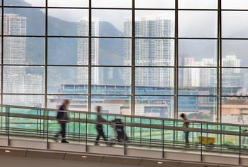 Passengers at the Hong Kong airport with bags