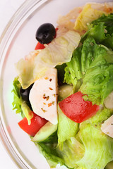 Greek salad with onion, tomato, cucumbers and cheese