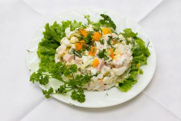 Traditional ukrainian salad olivier on white