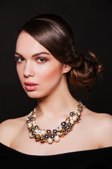 beautiful woman with evening makeup wearing jewelry