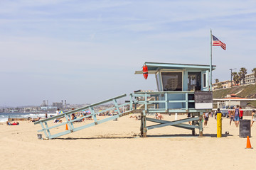 Wood lifeguard hut protecting busy Southern California beach