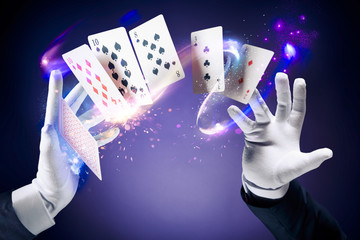 Wall Mural - High contrast image of magician making card tricks