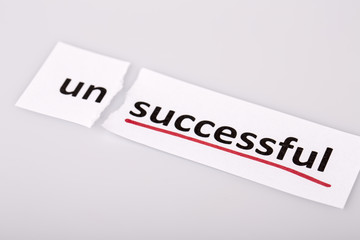 The word unsuccessful changed to successful on torn paper