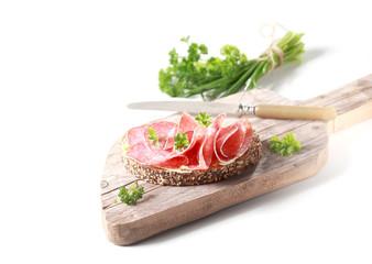Preparing a delicious salami sandwich
