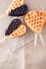 Romantic heart shaped waffle lollipops