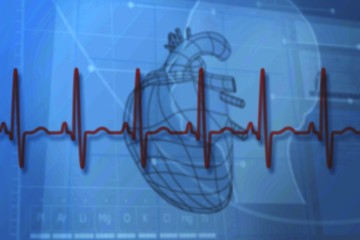 Blue medical background with heart diagram and ecg