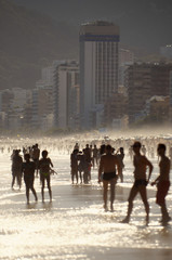 Silhouettes of Carioca Brazilians Standing Ipanema Beach Sunset