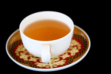 cup of tea on black background
