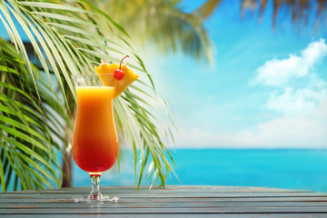 Aluminium Prints Oceania Refreshing orange cocktail on beach table.