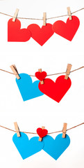 red and blue hearts with clothespins on rope on white background