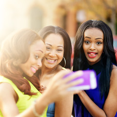 three african girls taking selfies with crazy faces