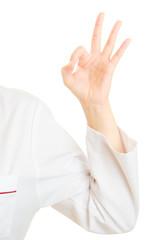 Hand of doctor showing ok okay hand sign gesture