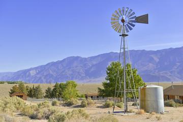 Vintage Water pump / Windmill in Rural landscape