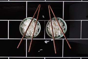 Creative artistic shapes using bowl of rice and chopsticks
