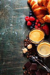 Coffee with croissants and berries