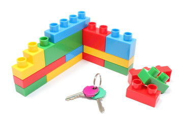 Wall of plastic colorful building blocks with home keys