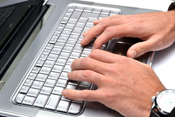 Businessman writing in a computer