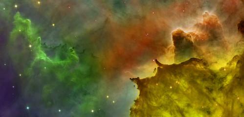 Wall Murals Nasa Colored clouds in Carina nebula.