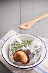 Baked jacket potato in aluminium foil