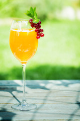 Stylish glass of orange and champagne cocktail