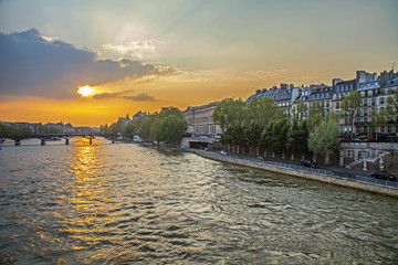 Paris, France.  View of the embankment of Seine at sunset