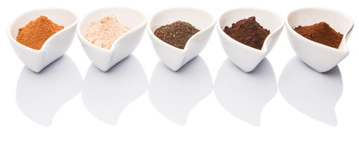 Cocoa powder, dried tea leaves and grounded coffee in ceramic