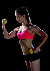 woman athlete working with weights