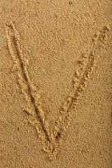 Alphabet letter written on wet beach sand