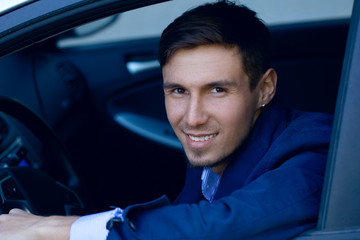 young business man in the car