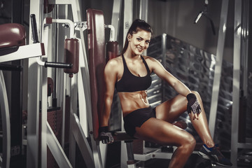 Wall Mural - athletic young woman resting during exercise in the gym